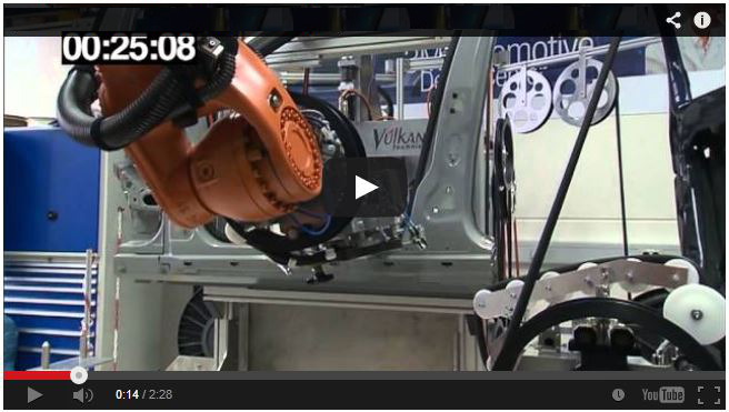 VIDEO: Door seal on body is applied in an automated process.