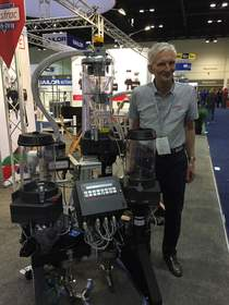 Plastrac's new family of cart-based blending systems was introduced at the 2015 National Plastics Exposition. Pictured with one of the new dual models is Ken Bullivant, Founder and President of Plastrac.