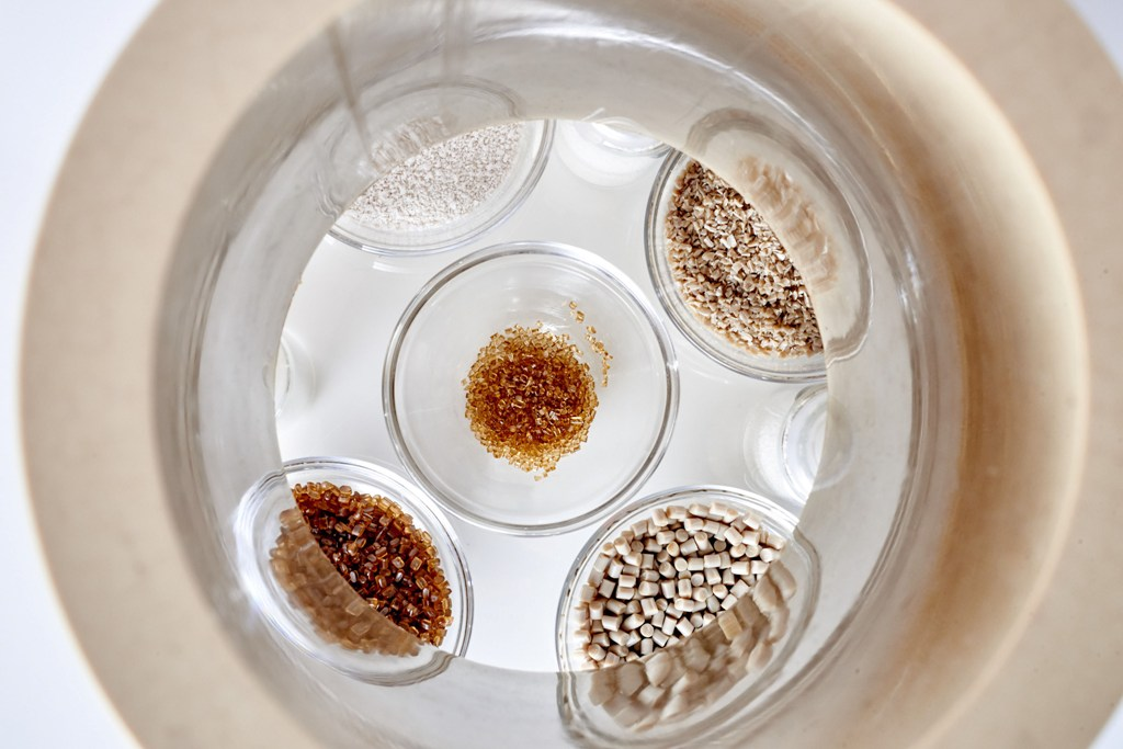 Micro granules from Vestakeep 5000 HCM shown in the middle as compared to granules or powders (source: Evonik)